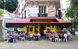 The French traditional cafe Chez Francis located in Montmartre area in Paris , France. Paris, France- July 28, 2018 : The French traditional cafe Chez Francis royalty free stock photography