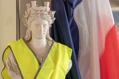 The French tricolor and Marianne, the symbols of the Republic and the yellow jackets protester Gilet jaune. Images dedicated to the movement of Yellow Vests and stock photography