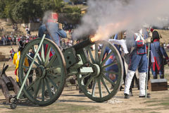 French troops firing cannon on the battlefield during the Representation of the Battle of Bailen Royalty Free Stock Photography