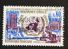 French United Nations postage stamp of 1970. FRANCE-circa 1970: French postage stamp commemorating 25th anniversary of the united nations with images of the Stock Images