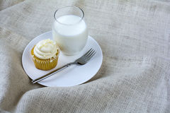 French Vanilla Cupcake and a glass of milk Stock Photo