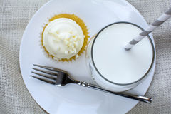 French Vanilla Cupcake and a glass of milk Royalty Free Stock Photography