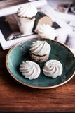 French vanilla meringue cookies or dessert made from whipped egg whites and sugar on a plate on a wooden table, selective focus. S. Weet food. Image with copy royalty free stock images