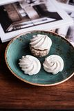 French vanilla meringue cookies or dessert made from whipped egg whites and sugar on a plate on a wooden table, selective focus. S. Weet food. Image with copy royalty free stock image