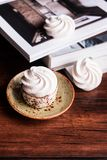French vanilla meringue cookies or dessert made from whipped egg whites and sugar on a plate on a wooden table, selective focus. S. Weet food. Image with copy royalty free stock photo