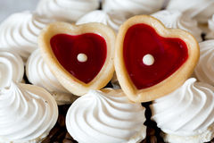 French vanilla meringue cookies and two sweet heart Stock Photography