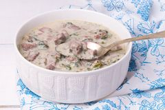 French veal ragout in white porcelain bowl. Blanquette de veau. Royalty Free Stock Photography
