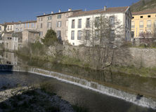 A French Village by the River. Houses beside the river in Lodeve, a small village in  Languedoc France Stock Photography