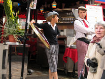 French vintage uniformed young touts at Montmartre cafe Stock Photography