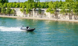 French water policemen in a speed boat on the river Seine Royalty Free Stock Photo