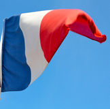 french waving flag in the blue sky  france  colour and wave Stock Photos