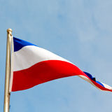 french waving flag in the blue sky  france  colour and wave Royalty Free Stock Images