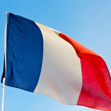 French waving flag in the blue sky  france  colour and wave Royalty Free Stock Photography