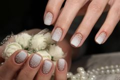 French wedding manicure. With flowers and beads royalty free stock photo