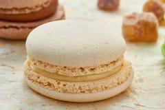 French white macaron on wrapping-paper Stock Photo