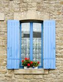 French window with blue shutters. Traditional French window with shutters. Fishing village, Brittany, Western France Royalty Free Stock Photography