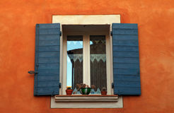 French window with blue shutters, Provence, France. Stock Image