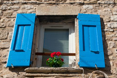 French window with shutters. Typical French pastel colored village window in Provence Stock Images