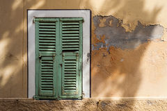 French window shutters grungy wall Royalty Free Stock Photo