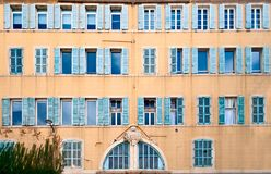 French windows. Texture of typical sothern french windows at the street Cours Jean Ballard in Marseille, France Royalty Free Stock Images