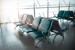 French windows of the airport terminal chairs Royalty Free Stock Photo