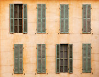 French windows with shutters. Image of windows with shutters on a rural french house. Taken in Paris, France Stock Image