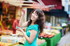 French woman choosing fruits on market Stock Photos