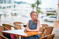 French woman in an outdoor cafe of Cannes Stock Image