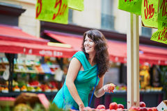 French woman selecting fruits on market in Paris Royalty Free Stock Images