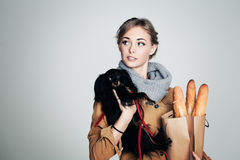 French Woman with Small Dog and Baguette. On Background with Copy Cpace Stock Image