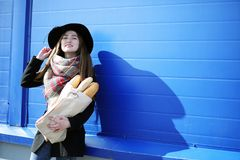French woman for a walk in grocery stores. Outdoorr Royalty Free Stock Image