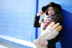 French woman for a walk in grocery stores. Outdoorr Stock Images