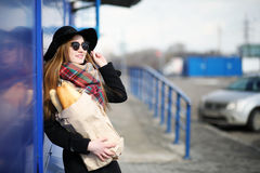 French woman for a walk in grocery stores. Outdoorr Royalty Free Stock Images