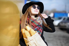 French woman for a walk in grocery stores. Outdoorr Royalty Free Stock Photography