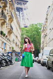 French woman walking with coffee to go and baguette Stock Photo