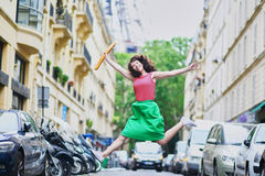 French woman walking with coffee to go and baguette, jumping Stock Photography