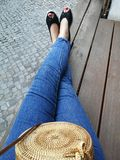 French women legs. Relaxing on bench royalty free stock photos
