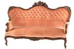 French wooden pink sofa. French wooden antique pink sofa isolated on white background Royalty Free Stock Image
