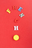 FRENCH word on red background composed from colorful abc alphabet block wooden letters, copy space for ad text. Learning. English concept stock photography