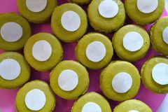 French yellow macarons background, close up Stock Images