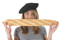 French young girl with typical bread Royalty Free Stock Image