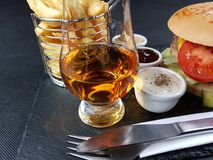 Frenchfries chips whisky glass glencairn singlemalt Stock Photo