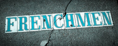Frenchmen Street in New Orleans. Tiled into the sidewalk to show the street name of this historic street in New Orleans' French Quarter Royalty Free Stock Photo