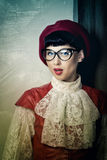 Frenchwoman beret, vintage dress and wearing glasses. Royalty Free Stock Photo