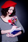 Frenchwoman with notebook Stock Photography
