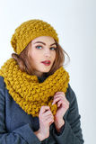 Frenchwoman. Young attractive Frenchwoman in knitted hat and scarf isolated on white background Stock Photo