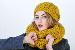 Frenchwoman. Young attractive Frenchwoman in knitted hat and scarf  on white background Stock Photos