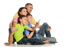 Frendly family on the floor Royalty Free Stock Photos