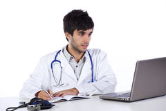 Frendly young doctor working with his laptop Stock Photography