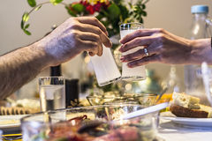 Frends drinking Turkish Traditional Drink Raki, Ouzo. Friends Sitting, Drinking, Say Cheers and drinking Turkish Traditional Drink Raki, Ouzo Stock Photos